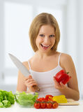 Happy girl preparing vegetarian food Stock Photos