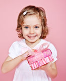 Happy girl with present Royalty Free Stock Photo