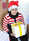Happy girl with present boxes stock image
