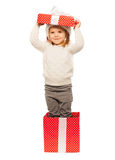Happy girl pretend to be a Christmas present Royalty Free Stock Images
