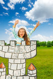 Happy girl in princess costume with hands up Stock Image