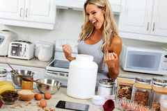 Happy girl with protein jar. Young smiling woman with natural raw protein jar royalty free stock photo