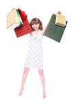 Happy girl with purchases. Royalty Free Stock Image