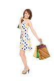 Happy girl with purchases. Royalty Free Stock Photography
