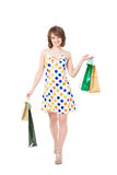 Happy girl with purchases. Royalty Free Stock Photo