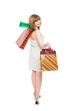 Happy girl with purchases. Royalty Free Stock Images