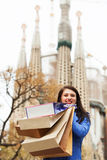 Happy girl with purchases in Barcelona Royalty Free Stock Image