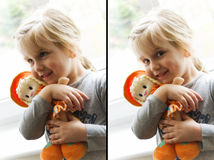 Happy girl with rag doll. Two portrait of a happy young blond girl cuddling a toy rag doll Stock Photo