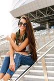 Happy girl on railing Stock Photos