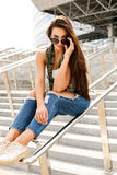 Happy girl on railing Stock Images