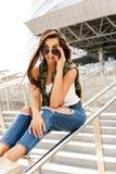 Happy girl on railing Stock Image