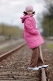 Happy girl on railway Stock Images