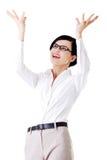 Happy girl with raised hands. Stock Photo