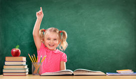 Happy Girl Raising Hand In The Classroom stock image