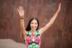 Happy girl raising hands up outside Royalty Free Stock Photo