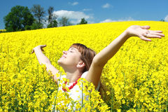 Happy girl in the rapeseed field Royalty Free Stock Images