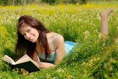 Happy girl reading Royalty Free Stock Photography