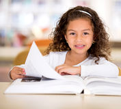 Happy girl reading a book Royalty Free Stock Photo