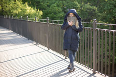Happy girl reading a book at the railing. Royalty Free Stock Photos