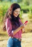 Happy girl reading a text message Stock Photos