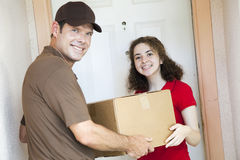 Happy Girl Receives Package Royalty Free Stock Photos