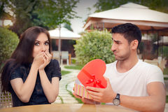 Happy Girl Receiving Heart Shaped Gift from her Boyfriend Royalty Free Stock Photo