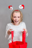 Happy girl with a red bag . Stock Images