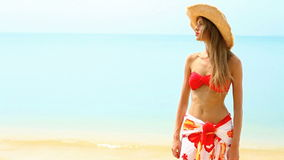 Happy girl in red bikini at tropical beach Royalty Free Stock Photography