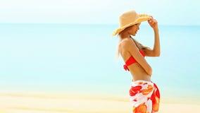 Happy girl in red bikini at tropical beach stock footage