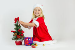 Happy girl in a red Christmas costume Royalty Free Stock Photo