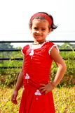 Happy girl in red dress Royalty Free Stock Photos