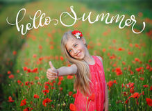 Happy girl in a red dress on poppy field and text Hello summer. Calligraphy lettering hand draw Royalty Free Stock Photos