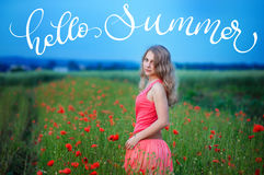 Happy girl in a red dress on poppy field and text Hello summer. Calligraphy lettering hand draw Royalty Free Stock Images