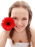 Happy girl with red flower Royalty Free Stock Image