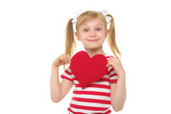 Happy girl with red heart Stock Images
