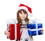 Happy girl in red santa hat holding gift boxes. isolated on whit Royalty Free Stock Photography