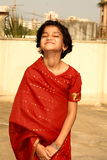 Happy girl in red sari Stock Photos
