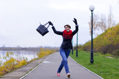 Happy girl in red scarf outdoor Royalty Free Stock Photography