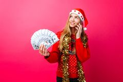Happy girl in red sweater and Santa hat, talking on phone and ho stock photos
