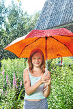 Happy girl with red umbrella under rain Royalty Free Stock Images
