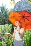 Happy girl with red umbrella under rain Stock Photo