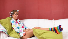 Happy girl relaxing on the couch Royalty Free Stock Image