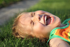 Happy girl relaxing on a grass Royalty Free Stock Images
