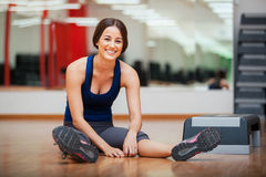 Happy girl relaxing at a gym Royalty Free Stock Images