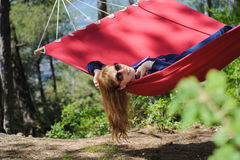 Happy Girl Relaxing In Hammock Royalty Free Stock Photography