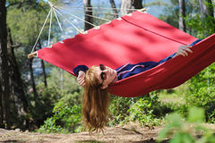 Happy Girl Relaxing In Hammock Royalty Free Stock Photos