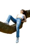 Happy girl relaxing outdoors on tree branch isolated Stock Photo