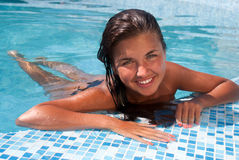 Happy girl relaxing in pool Stock Image