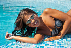 Happy girl relaxing in pool Stock Photo