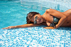 Happy girl relaxing in pool Stock Images